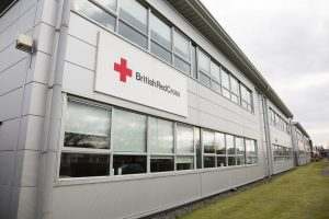 """Glasgow, UK - March 31, 2013: British Red Cross offices in Hillington, Glasgow. Part of the UK branch of the International Red Cross and Red Crescent Movement, an international humanitarian organisation."""